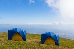 Two Tent on a grass under  blue sky Royalty Free Stock Photo