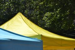 Two Tent Tops in Portland, Oregon. These are the tops of two tents in Portland, Oregon in front of green trees Stock Photography