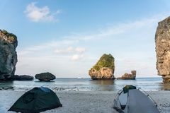 Two tents on the beach with Beautiful Rocks view. Morning at Nui Bay Beach, Phi-Phi, Thailand, Krabi province Andaman stock photos