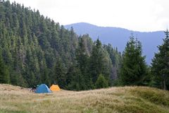 Two tents and bicycles on a meadow in the mountains. Two tents and two bicycles on a meadow in the mountains royalty free stock images