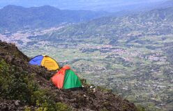 Two tents camping on mountain above valley Sumatra