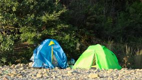 Two tents are in the mountains stock video