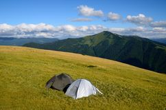 Two tents in mountains Stock Photos