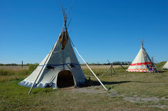 Two Tepees. Two teepees against a blue sky Royalty Free Stock Photos