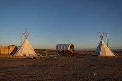 Navajo Campground, Page, Arizona. Two tepees and a covered wagon at sunset on a Navajo campground in the United States of America stock photos
