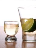 Two tequila cups and lime Royalty Free Stock Image