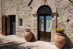 Two terracotta large jars to door side Royalty Free Stock Images