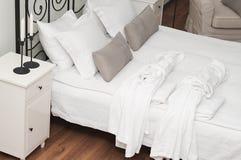 Two terry bathrobe on bed Royalty Free Stock Photos