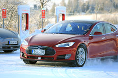 Two Tesla Model S Electric Cars in Winter stock photo