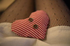Two textile hearts with buttons on the legs Stock Images