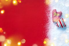 Two textile hearts together on white snow and red background. Love and St. Valentines Day concept Stock Image