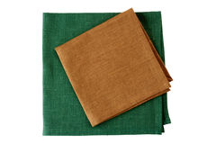Two textile napkins, brown and green, on white Stock Photo