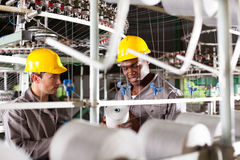 Two textile workers Royalty Free Stock Image