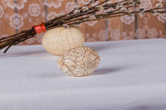 Two textured white Easter eggs and  bunch of willow branches Royalty Free Stock Photos