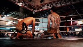 Two Thai boxers in ring Royalty Free Stock Photo
