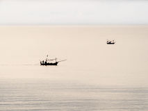 Two thai fisherman boat in the cloudy evening sea Royalty Free Stock Images
