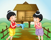 Two thai girls on water festival day Royalty Free Stock Photo