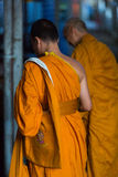 Two Thai monks standing and praying in Koh Chang Island. Stock Photos