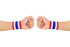 Two Thai national color cloth wristbands on the guy's wrists on white background. With clipping path Royalty Free Stock Photo