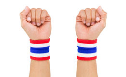 Two Thai national color cloth wristbands on the guy's wrists on white background. With clipping path Stock Photos