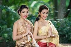 Two Thai woman wearing typical Thai dress. Two Thai women wearing typical Thai dress, identity culture of Thailand Stock Photo