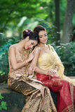 Two Thai woman wearing typical Thai dress Royalty Free Stock Image