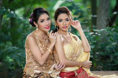 Two Thai woman wearing typical Thai dress Stock Images