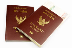 Two Thailand Passports with Thai Banknote. Thailand Passports with Thai Banknote, Thailand Passports with Banknote, 2 of Thailand Passports with Thai Banknote Stock Photos