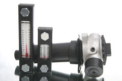 Two thermometers and metal element. Used in hydraulic construction Stock Images