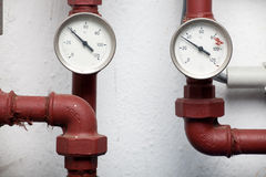 Two thermometers pipes Royalty Free Stock Image