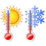 Two thermometers, sun and snowflake. Two thermometers, high and low temperature. Symbolize the heat and cold. Sun and snowflake Stock Photography