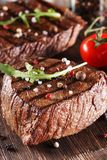 Two thick portions of roasted or grilled beef Royalty Free Stock Images