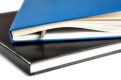 Two thick writing-books with a pen. On  white background Stock Photos