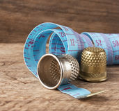 Two thimble and measuring tape Royalty Free Stock Image