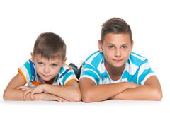 Two thoughtful brothers on the floor Stock Images