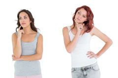 Two thoughtful casual young female friends Royalty Free Stock Photo