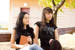 Two thoughtful looking women Royalty Free Stock Photography