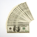 Two Thousand Five Hundred Bills. US Currency One Hundred Dollar Bills arranged, fanned out totaling two thousand five hundred dollars, isolated on white Royalty Free Stock Photos