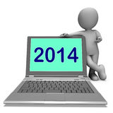 Two Thousand And Fourteen Character And Laptop Shows Year 2014 Stock Photography