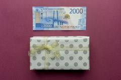Two-thousand money with present box with bow isolated on red background royalty free stock images