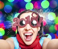 Two Thousand Nineteen. 2019. Two Thousand Nineteen. Girl in glasses taking selfie. New Years concept. 2019 New Year royalty free stock photography