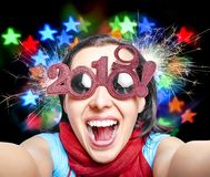 Two Thousand Nineteen. 2019. Two Thousand Nineteen. Girl in glasses taking selfie. New Years concept. 2019 New Year royalty free stock image