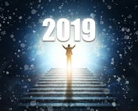 Two Thousand Nineteen. Man at the top of a stone staircase or pyramid raises his hands up to the number of 2019. Two Thousand Nineteen. A man at the top of a royalty free stock photos