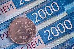 Two thousand ruble banknotes and two-ruble coin. Close up Stock Photos
