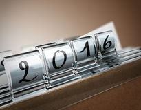 2016, Two Thousand Sixteen. File tab with focus on 2016 year, beige background. Image concept for illustration of deadline in  two thousand sixteen Stock Photography