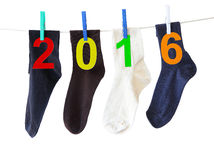 Two thousand sixteen New year. Socks and numbers 2016 (New year of Two thousand sixteen ) hanging on a clothesline. Isolated on a white background royalty free stock photography
