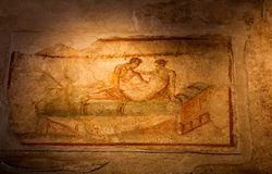 Two thousand years old roman antique erotic fresco in Pompeii Royalty Free Stock Photography
