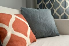 Two throw pillows lie on a sofa. Living room interior fragment.  royalty free stock photography
