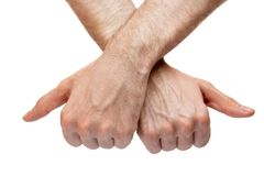 Two thumb's up. crossed arms Stock Photos