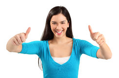 Two Thumbs Up!!. A young woman is showing her appreciation towards a job very well done Royalty Free Stock Images